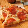 Pepperoni and sausage pizza — Stock Photo