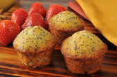 Poppyseed muffins with strawberries — Stock Photo
