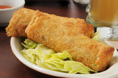 Egg rolls and beer — Stock Photo
