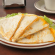 Cheddar cheese quesadillas on a bed of lettuce with coffee — Stock Photo