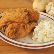 Fried chicken with coleslaw — Stock Photo