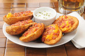 Potato skins iwth bacon and cheese — Stock Photo