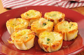 Mini quiche with bacon bits — Stock Photo
