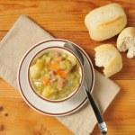 Split pea soup and rolls — Stock Photo #35872209