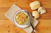 Split pea soup and rolls — Stock Photo