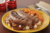 Bangers and mash with baked beans — Stock Photo