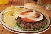 Hamburger with potato chips — Stock Photo
