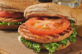 Grilled salmon burgers — Stock Photo