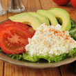 Cottage cheese with tomato and avocado — Stock Photo #36960143