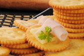 Crackers with ham and cheese — Stock Photo