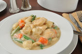 Bowl of chicken and dumplings — Stock Photo