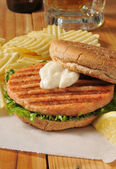 Grilled salmon burger — Stock Photo