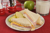 Ham and cheese sandwich with milk — Stock Photo