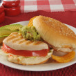 Chicken sandwich with avocado slices — Stock Photo