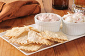 Flatbread crackers with dips and beer — Стоковое фото