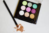 Colored eye shadow brush — Stock Photo