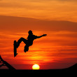 Skateboard at sunset — Stock Photo