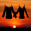 Clothes hanging at sunset — Stock Photo