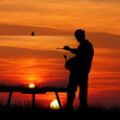 Painter at sunset — Stock Photo