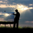 Stock Photo: Painter at sunset