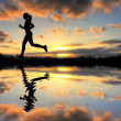Girl running at sunset — Stock Photo