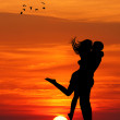 Lovers at sunset — Stock Photo