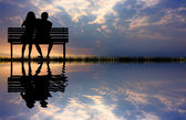 Lovers on bench — Stock Photo