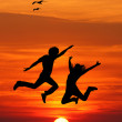 Foto Stock: Jumping at sunset