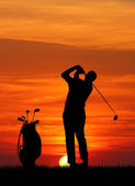 Golf at sunset — Stock Photo