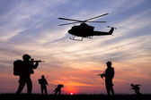 Soldiers at sunset — Stock Photo