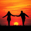 Couple at sunset — Stockfoto