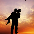 Lovers at sunset — Stockfoto