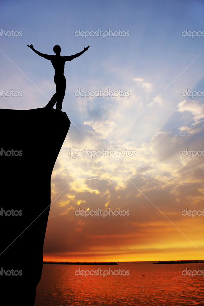 Man on the cliff at sunset  Stock Photo #15706929