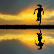 Stock Photo: Girl running at sunset