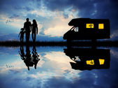 Family traveling with camper — Stok fotoğraf