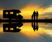 Camper at sunset — Stockfoto