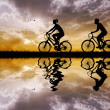 Stock Photo: On bicycles