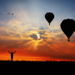 Stock Photo: Balloons at sunset