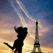 Stock Photo: Lovers kissing in Paris
