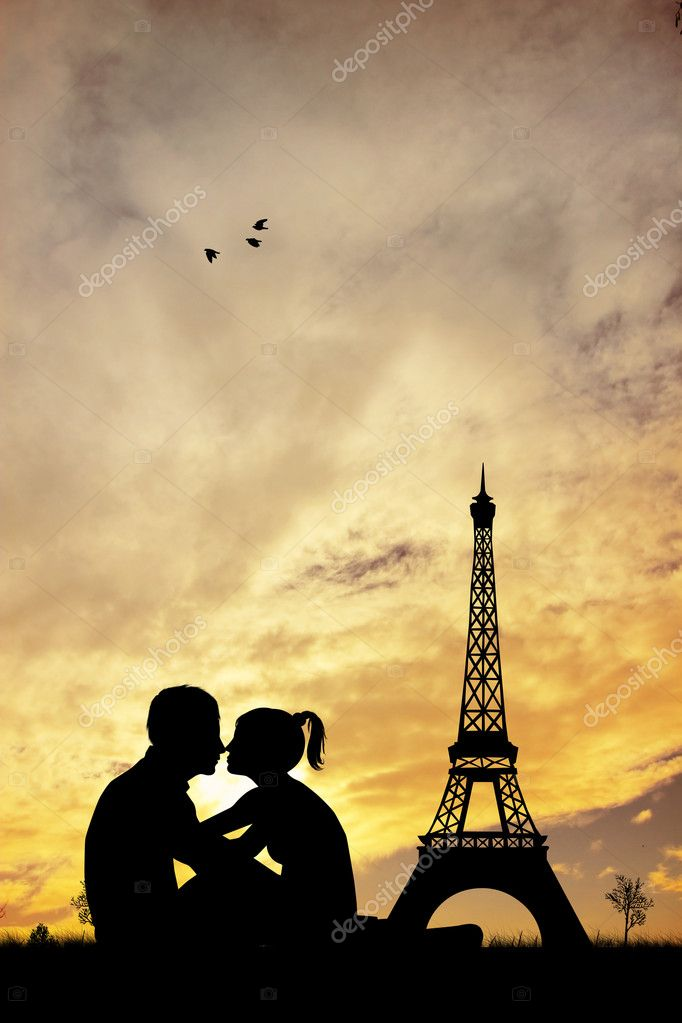 Romantic couple in Paris at sunset — Stock Photo #18366847