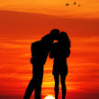 Kiss at sunset — Stock Photo