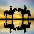 Lovers on horseback — Stock Photo
