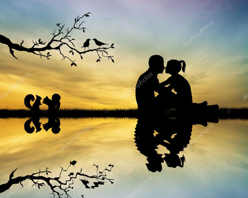 Kissing at sunset — Stock Photo #18552741