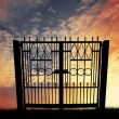 Stock Photo: Gate at sunset