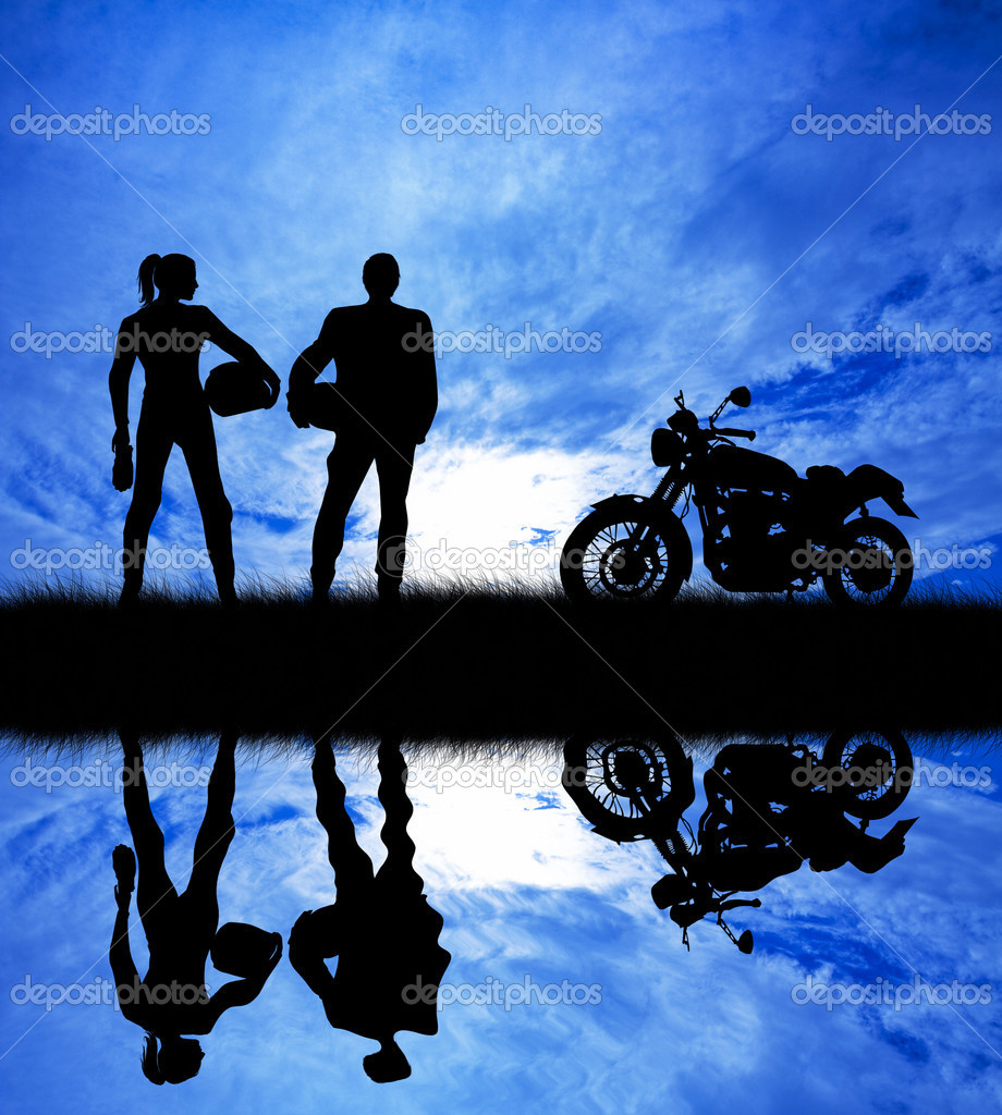 Pair of motorcyclists at sunset  Stock Photo #19079637