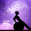 Pilates at sunset — Stockfoto