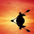 Kayaker at sunset — Stock Photo