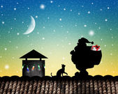 Santa Claus on roof — Stockfoto