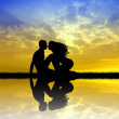 Kissing at sunset — Stockfoto