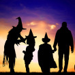 Family in costume at Halloween — Stock Photo